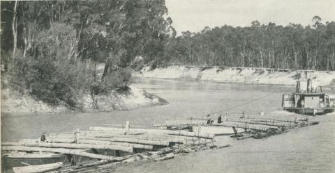 Logs chained to the outriggers on a barge 'train', Echuca, 1950