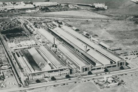 Aerial view of the Ford Company and wharf facilities on Corio Bay, 1955