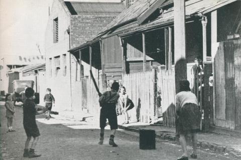 The childrens playground, a slum street, Richmond, 1942