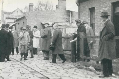 Premier of Victoria A. A. Dunstan visits Melbourne slum areas, 1942