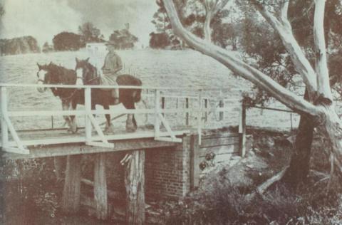 Man on horseback crossing wooden bridge, Bayswater, 1947