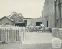 Stacking pots ready for firing, Nunawading, 1956