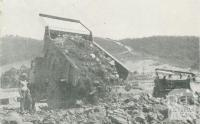 Dumping rock fill on the dam seat, Upper Yarra Dam, 1954