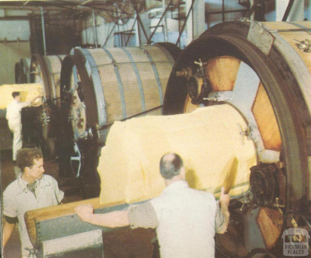 Taking butter from the churns at the Korumburra factory, c1952